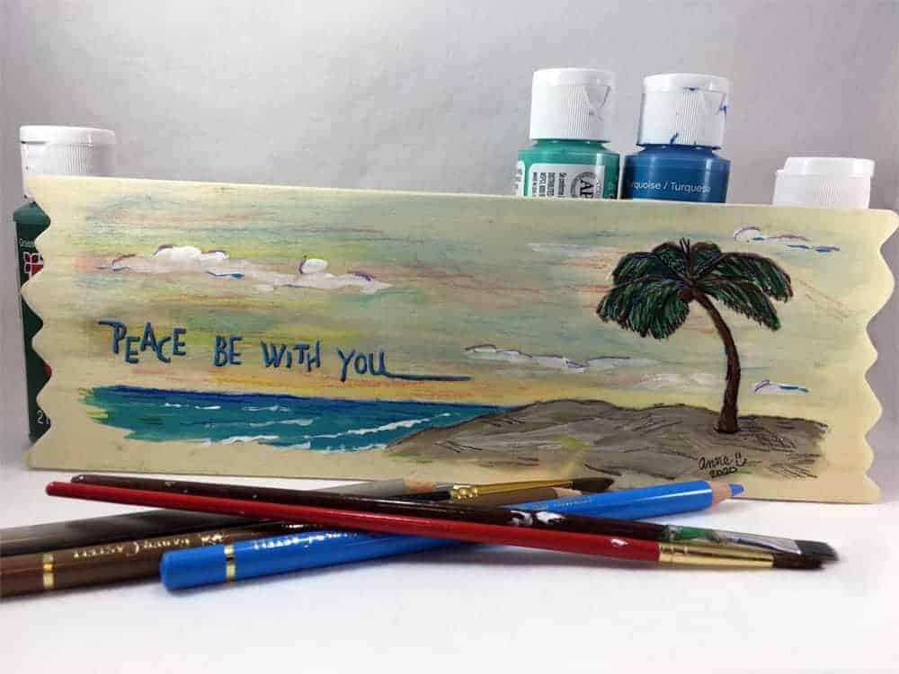 """Image: acrylic and oil pencil painting of a palm tree on the beach, with lettering """"Peach be with you."""""""