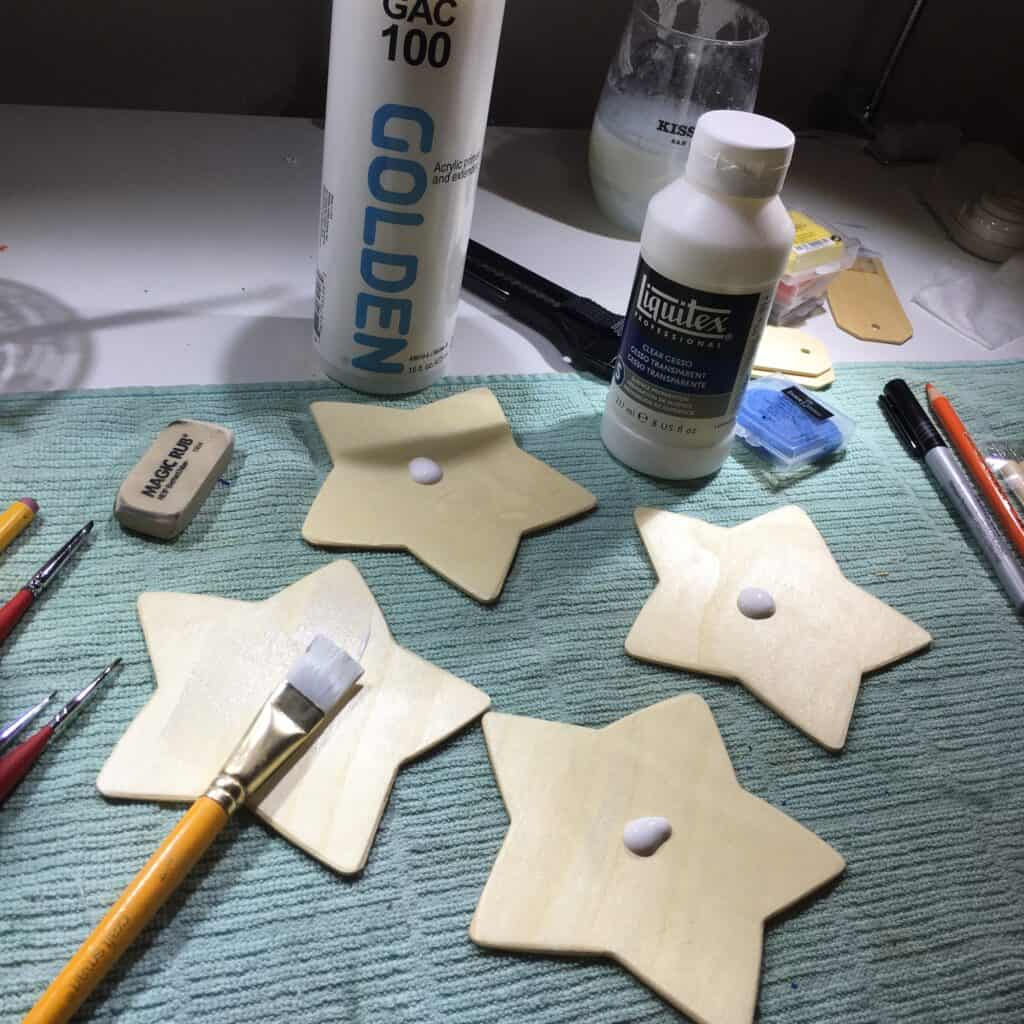 Image: Wooden stars with gesso applied.